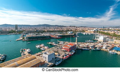 Marina and city skyline of Barcelona from cable car...