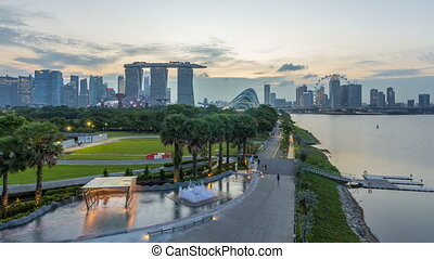 Marina Bay Sands, Gardens by the bay with cloud forest, flower dome and supertrees day to night timelapse after sunset