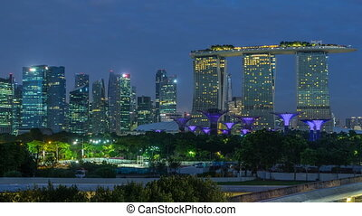 Marina Bay Sands, Gardens by the bay with cloud forest, flower dome and supertrees night to day timelapse before sunrise