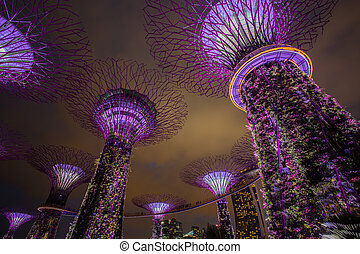 MARINA BAY ,SINGAPORE, MARCH 16, 2015: Big Tree light show night time for people watch the show in Garden By The Bay, Singapore