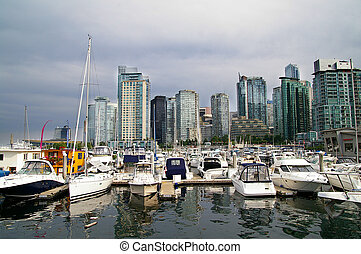 marina boats and city skyline in Vancouver, Canada