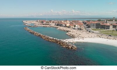 Marina di Pisa from the sky, Italy. Beautiful aerial view of coastline and cityscape.