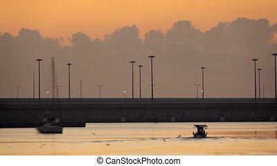 Marina entrance with sailing boat at sunrise - Timelapse of...