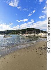 Marina with moored yachts and sandy beach, Riviera di Levante, Porto Venere, Italy