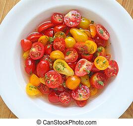 Marinated cherry tomatos in white dish