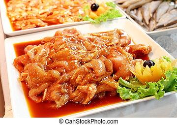 Marinated chicken - A Marinated chicken on a white plat