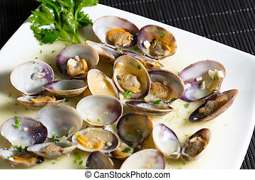 Delicious fresh clams cooking with seafood