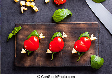 Marinated fillet with tomato heart shaped.  Appetizer for a party. Valentine's Day treat for your loved one.