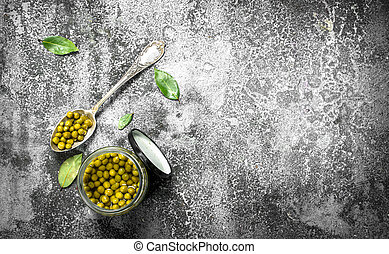 Marinated green peas in glass jar.