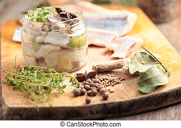 Marinated herring - Homemade marinated herring in a jar with...