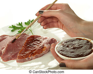 Marinating meat - Marinating slices of beef with marinade...