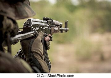 Marine aiming from machine gun - Marine sniper aiming from...