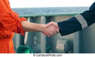 marine contractor businessman handshaking with worker on the...