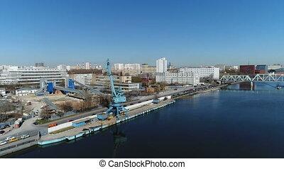 Marine crane on the embankment