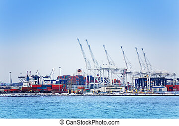 Marine cranes and containers at maritime port