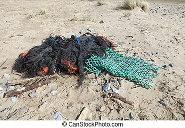 Marine debris - Tangled abandoned marine debris on the Gower...