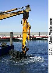 marine dredging digging sea bottom black mud in marina