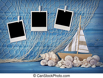 Marine life decoration and instant photos on blue shabby...