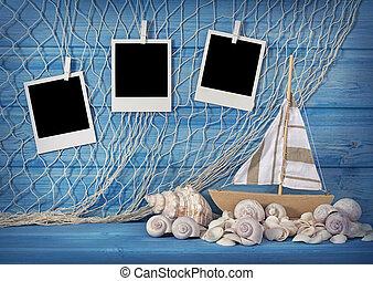 Marine life decoration and instant photos on blue shabby ...