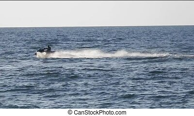 Marine motorcyclist rides the waves