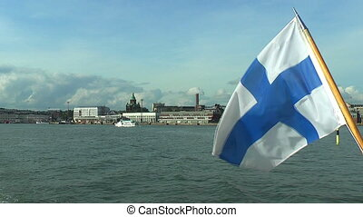 Marine panorama of Helsinki with Finnish flag