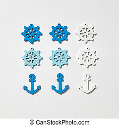 Marine pattern from anchors and wheels.