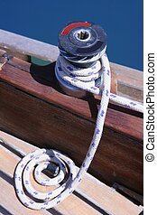Marine rope and winch over wooden deck