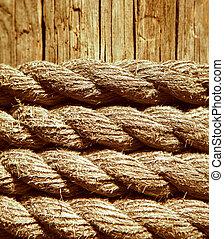 marine rope on weathered old wood background