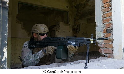 Marine soldier mounting shotgun on window defending ruined building