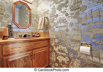 Marine style bathroom interior with view of vanity cabinet and mirror.