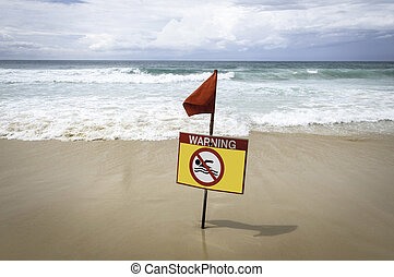 Marine yellow warning sign with a red flag.