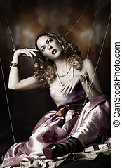 Fashion portrait of blond woman - marionette on string. ...