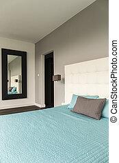 Marital bed in bright room