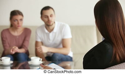Marital therapy session - Young upset couple visiting...