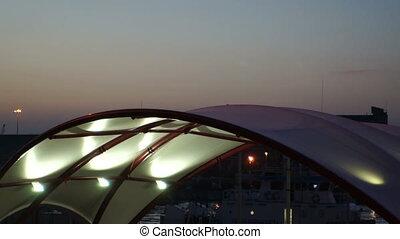 Maritime customs point at sunset under artificial lighting