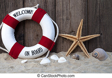 Maritime Decoration with shells, starfish, sand and safety buoy