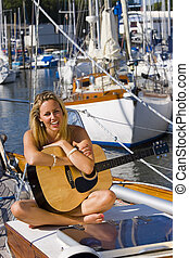 Maritime Music - A gorgeous young blond woman sitting on the...