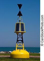 Marker bouy - A bright yellow solar powered marker bouy
