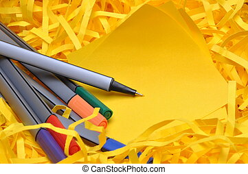 Markers with yellow sticky note