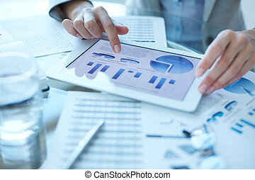 Hands of businesswoman working with electronic document in touchpad