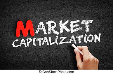 Market capitalization text on blackboard, business concept ...