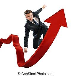 Market control - Determined businessman over a big red arrow
