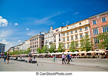 houses and restaurants on a Market square in Cracow, Poland