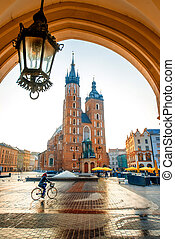 Beautiful view on St. Mary's Basilica at the market square in Krakow on the sunrise