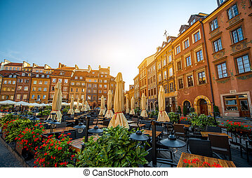 Market square with cafe and restaurants on a beautiful sunny morning in Warsaw, Poland