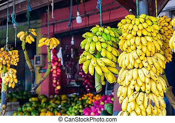 Market stall with bananas and other fruits
