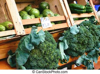 Market vendor cart with varied vegetables