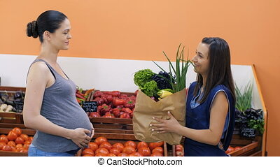 Marketer Gives Vegetables to Pregnant Woman