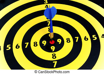 Marketing and success - Dart hitting the center of the...