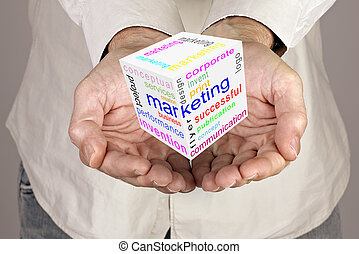 Marketing communication world cube  in male hands
